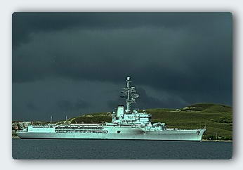French Warship in Noumea with storm clouds gathering.
