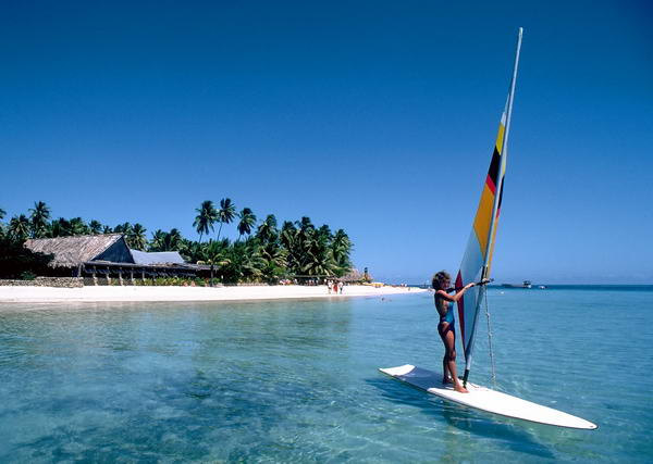 Freddy windsurfs back from the Plantation Resort on Malolo lailai